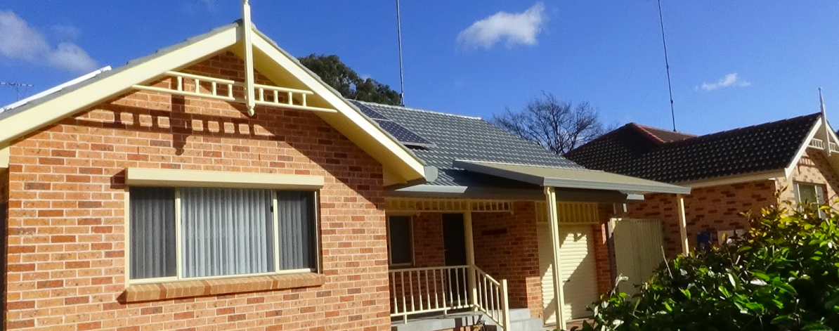beautiful house - roof guttering system in figtree